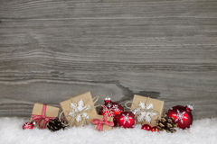 Red Christmas presents wrapped in natural paper on old wooden gr stock photo