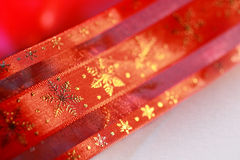Red Christmas ribbon. With golden snowflakes Royalty Free Stock Photos