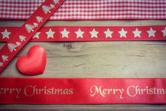 Red christmas ribbon and a love heart Stock Photo