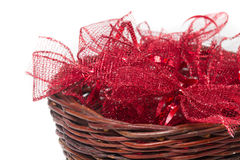 Red christmas ribbons in wicker basket Stock Photo