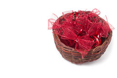 Red christmas ribbons in wicker basket Royalty Free Stock Photo