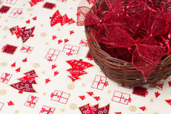 Red christmas ribbons in wicker basket Stock Images