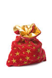 Red christmas sack full of gifts isolated Stock Photo