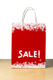 Red Christmas Sale Bag. A Winter or Christmas sale shopping bag in red with white snowflake borders at top and bottom, and the word 'SALE!' in the lower half stock photos