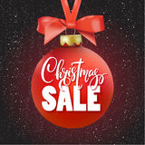 Red Christmas Sale ball with ribbon and a bow, hand drawn lettering. Stock Images