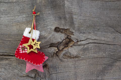 Red christmas or santa boot on a wooden old shabby country style Stock Images