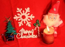 Red Christmas: Santa and Christmas tree and gifts in red background Royalty Free Stock Photos