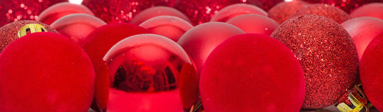 Red christmas shinny globes, christmas tree ornaments. Royalty Free Stock Images