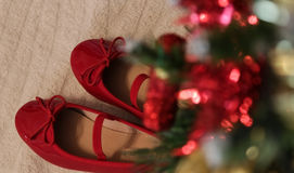 Red Christmas shoes - waiting a baby stock photography