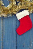 Red Christmas sock on blue background Stock Images
