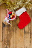 Red Christmas sock on brown background Stock Photo