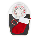Red christmas sock and scales on white background Royalty Free Stock Photos