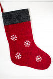 Red Christmas sock with snowflakes Royalty Free Stock Images