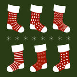 Red Christmas socks with different patterns on a green background Stock Image