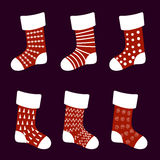Red Christmas socks with different patterns. Vector Royalty Free Stock Images