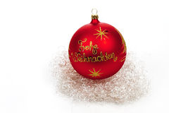 Red christmas sphere and angel hair on white background Stock Images