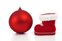 Red christmas sphere and boot on white background Stock Photo