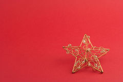 Red christmas star. Red star against red background with copyspace, christmas star with glass pearls Stock Photography