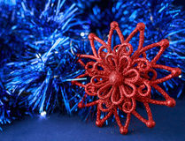 Red Christmas star on blue holiday background. Merry Christmas and New Year card Royalty Free Stock Photo