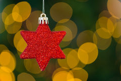 Red christmas star decoration hanging Royalty Free Stock Image