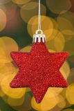 Red christmas star decoration hanging Royalty Free Stock Photos