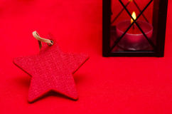 Red christmas star with free space. Red christmas star and burning lantern with free space Royalty Free Stock Images