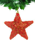 Red christmas star isolated. Red christmas star hanging from a green garland, isolated in white Stock Photos