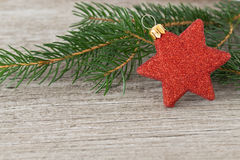 Red christmas star on a wooden background stock photo
