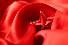 Red Christmas star, wrapped in cloth Stock Image