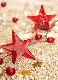 Red Christmas stars. Red vitreous Christmas stars and two golden on a festive christmas background stock photo