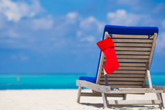 Red Christmas stocking on chair longue at tropical Royalty Free Stock Photography