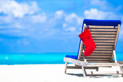 Red Christmas stocking on chair longue at tropical Royalty Free Stock Photos