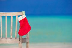 Red Christmas stocking on chair  at outdoor cafe Stock Photography
