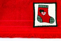 Red Christmas stocking hanging on red background royalty free stock photography