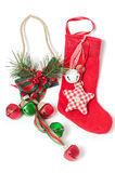 Red Christmas stocking and jingle bells Royalty Free Stock Images