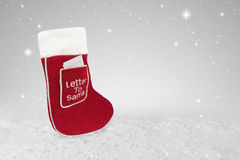Red Christmas stocking with a letter to Santa. In the front pocket Royalty Free Stock Photography