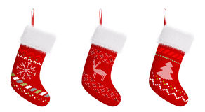 Red christmas stockings  3d rendering. Red christmas stockings with patterns  over white 3d rendering Royalty Free Stock Photo