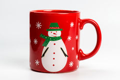Red christmas tea mug with snowman on white Stock Images