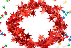 Red Christmas tinsel frame. Red Christmas tinsel with stars Royalty Free Stock Photo