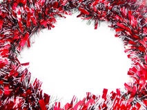 Red Christmas tinsel garland Stock Images