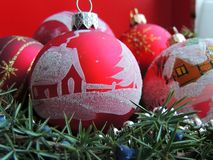 Red Christmas toy balls background. Red Christmas toy balls with house ornament background stock image