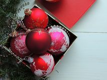 Red Christmas toy balls background. Red Christmas toy balls with house ornament background stock photo