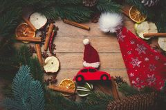 Red Christmas toy car with decoration around. On wooden background Stock Photo