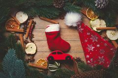Red Christmas toy car with decoration around. On wooden background Royalty Free Stock Photos