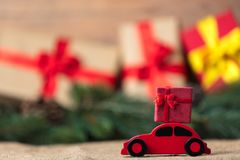 Red Christmas toy car and gift. On Christmas decoration background Royalty Free Stock Image