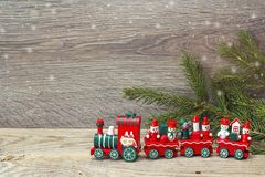Red Christmas toy train with fir branches and copy space. Stock Images