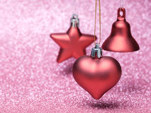 Red Christmas toys on glitter background Royalty Free Stock Images