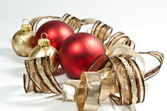Red christmas tree balls. Brown and gold ribbon Royalty Free Stock Photography