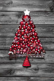 Red christmas tree with balls on old wooden shabby background. Royalty Free Stock Photos