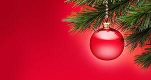 Red Christmas Tree Banner Background. A red Christmas ornament with a tree and red background Stock Images